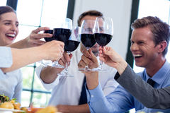Group of businesspeople toasting wine glass during business lunch meeting Royalty Free Stock Photos