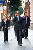 Group Of Businesspeople Walking Along Street Stock Photography