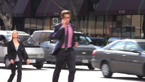 Group Of Businesspeople Walking Along Street stock video