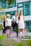 Group of businesspeople walking in a row Stock Image