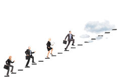 Group of businesspeople walking towards the heights Royalty Free Stock Photo
