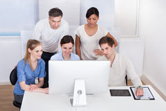 Group Of Businesspeople Working On Computer Stock Images
