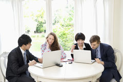 Group of businesspeople working on laptop Royalty Free Stock Images