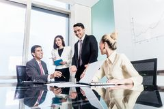 Group of businesswomen and businessmen negotiate contract Royalty Free Stock Photography