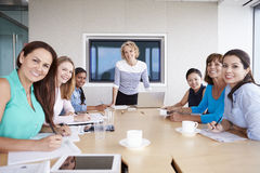 Group Of Businesswomen Meeting Around Boardroom Table Stock Images