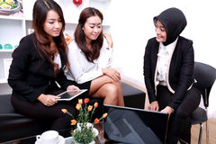 A group of businesswomen meeting at office livingroom stock images