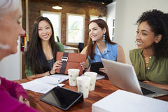 Group Of Businesswomen Meeting To Discuss Ideas Stock Photos