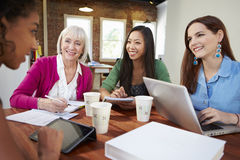 Group Of Businesswomen Meeting To Discuss Ideas Stock Photography