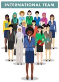 Group of businesswomen standing together on white background in flat style. International business team and teamwork Stock Photography