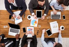 Group of busy business people meeting in office, top view Stock Photography