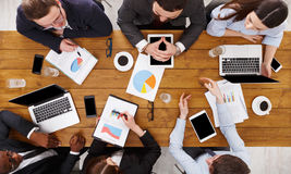 Group of busy business people meeting in office, top view Stock Photo
