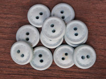 Group of buttons on the wooden table Royalty Free Stock Image