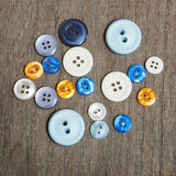 Group of buttons on the wooden table Royalty Free Stock Photos
