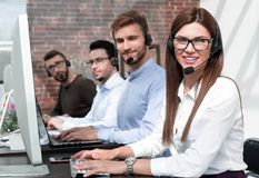 Group of call center specialists work with clients. Photo with copy space stock photos