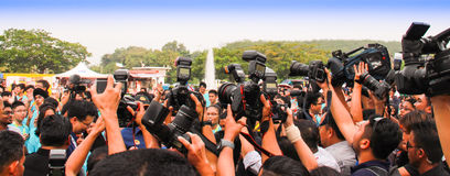 Group of cameramen and photographers. Group of cameramen taking pictures and videos of a VIP (hidden) at one outdoor function royalty free stock image