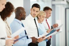 Row of applicants. Group of candidates for new vacancies waiting for their turn for interview Royalty Free Stock Photo