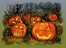 Group of candle lit carved Halloween pumpkins on the field Stock Photo