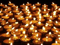 Group of  candles on  black background. Royalty Free Stock Photos