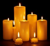 Group of  candles on  black background. Stock Photo