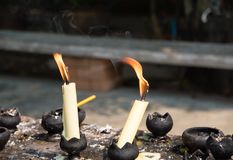 Flame and smoke from candles. A group of candles burning in smoke with dripping wax stock images