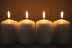 Group of candles. Group of four burning candles closeup as a background Royalty Free Stock Photo