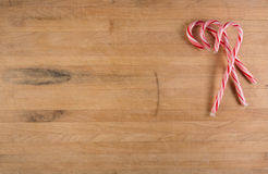 Group of Candy Canes Sits on Cutting Board Stock Photo