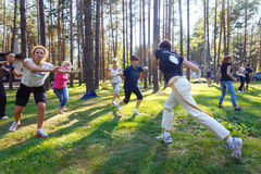 Group of capoeira students with master teacher royalty free stock photo