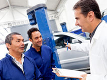 Group of car mechanics Royalty Free Stock Images
