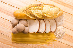 Group of Carbohydrates. For diet, bread, rice, oat, potatoes, pasta on wood table royalty free stock images