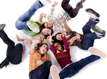 Group of carefree teenagers lie royalty free stock image