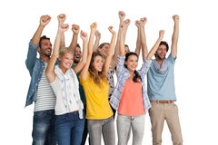Group of casual happy young people raising hands Royalty Free Stock Photos