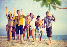 Group of Casual People Partying on a Beach stock photos