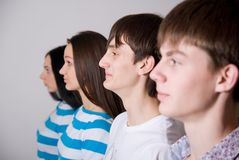 Group of casual people in a row Stock Images