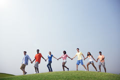 Group Casual People Walking Together Outdoors Concept.  Royalty Free Stock Photos