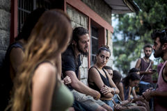 Group of casual tourists take a break, enjoy and discuss beside a shelter compound, Himachal Pradesh. Stock Image