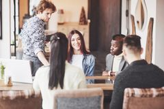 Group of casually dressed businesspeople discussing ideas. Creative professionals gathered for discuss the important royalty free stock photography