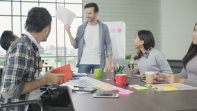 Group of casually dressed businesspeople discussing ideas in the office. stock video footage
