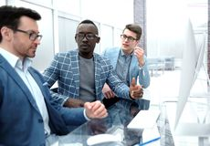 Group of casually dressed businesspeople discussing ideas in the office royalty free stock images