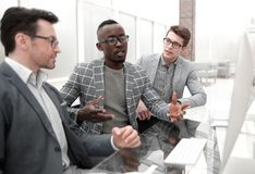 Group of casually dressed businesspeople discussing ideas in the office stock image