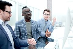 Group of casually dressed businesspeople discussing ideas in the office stock photography