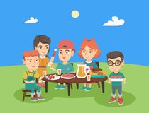 Group of caucasian children having fun at picnic. Group of caucasian joyful children having fun at picnic. Company of happy boys and girls having picnic in the Stock Images