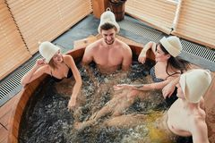 Group of caucasian diverse friends enjoying jacuzzi in hotel spa stock photos