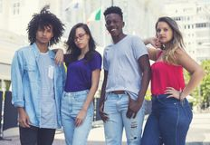 Group of caucasian and latin american and african young adults. Outdoor in the city royalty free stock photography