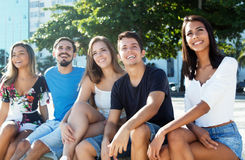 Group of caucasian and latin young adults looking around Royalty Free Stock Photo