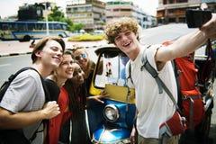 Group of caucasian tourists taking selfie infront of Tuk Tuk Stock Image