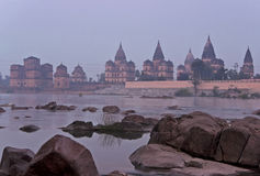 Group of Cenotaphs in the foggy early morning in India's Orchha. Stock Photos
