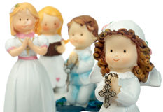 Group of ceramic dolls praying. Ceramic doll praying isolated on white Royalty Free Stock Photos