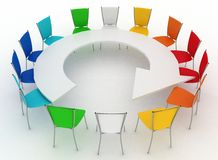 Group of chairs stands at a table as an arrow Stock Photo