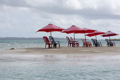 Group of chairs and umbrella on tropical beach, venezuela Stock Images