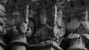 Group of characters on the capitals part 2. Shot and black and white, detail on the sculpture on the facade of this historic building representing some plants / Stock Photos
